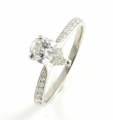 Platinum Pear Shaped Diamond Ring with Diamond Shoulders